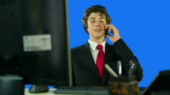 Boy in Suit At Work Making A Call Stock Footage