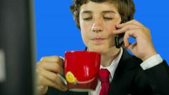 Close up on Business Boy Drinking Coffee And Calling Stock Footage