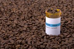 Coffee medicine bottle surrounded by beans Stock Photos