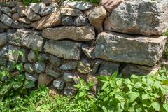 rock wall and grass at the contryside - stock photo