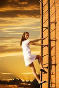 Girl on fire climbs stairs Stock Photos