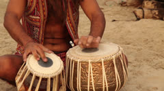 Hippy play on the drum and sit on the beach - stock footage