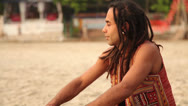 Stock Video Footage of Hippy play on the drum and sit on the beach