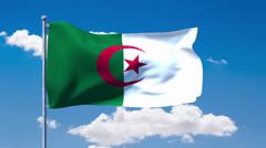 Algerian flag waving over a blue cloudy sky Stock Footage