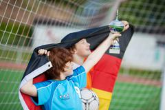 Young soccer players with trophy and flag Stock Photos
