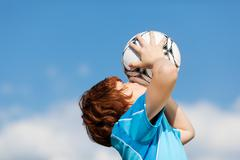 Happy winner kissing soccer ball Stock Photos