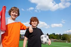 Two young students on soccer field Stock Photos