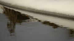Melting ice - stream flowing early in spring Stock Footage