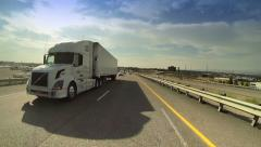 Trucks on road. Truck driving on freeway. Eighteen Wheeler.  - stock footage