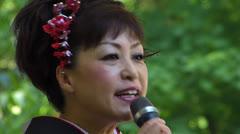 Japanese Shamisen Musician explaining instrument Shamisen in Japanese Stock Footage