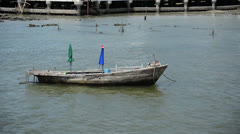 Floating fishing boat at the coastline Stock Footage