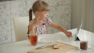 Stock Video Footage of Pretty little girl at kitchen eating chocolate sandwich drinking juice