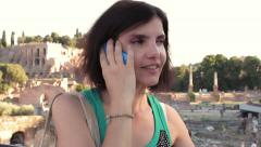 Cute woman is calling in Rome city center: talking, smartphone, mobile phone, Stock Footage