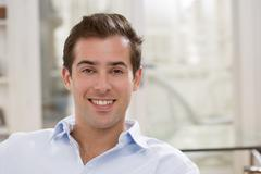 Interior portrait of looking relaxed happy male - stock photo