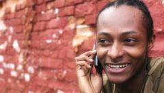 African American Male on cell phone pan Stock Footage