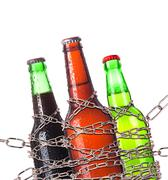 alcohol abuse concept - beer locked on a chain - stock photo