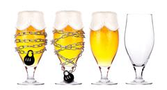 Alcohol abuse concept - beer locked on a chain Stock Photos