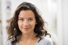 Portrait of beautiful young brunette woman with attractive smile - stock photo