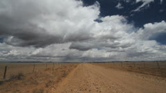 New Mexico Road and clouds c Stock Footage