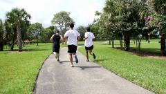 Men jogging side by side.HD Stock Footage