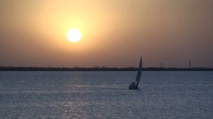 Sailboat at sunset s2 Stock Footage