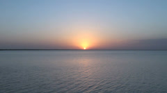 Sunset over lake zoom in s2 Stock Footage