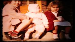 314 - young girls play on front porch, go for walk - vintage film home movie Stock Footage