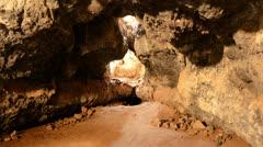 Light Rays Shine inside of Lava Tube Cave - 4K Stock Footage