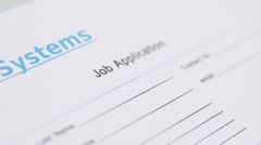 Filling in Job Application form Stock Footage