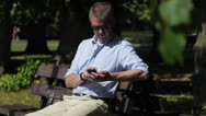 Stock Video Footage of Man with smartphone in park