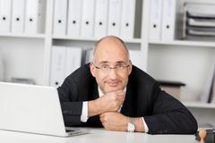 Confident businessmann leaning his head on Stock Photos