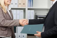 shake hands after an interview - stock photo