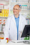 Confident pharmacist behind the counter Stock Photos