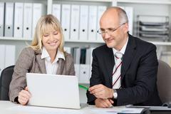 businesswoman present at laptop - stock photo