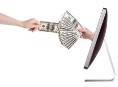 Computer making money concept isolated Stock Photos