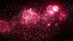 Colorful fireworks exploding in the night sky Stock Footage