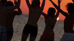 Teenagers Enjoying Fun Beach Sunset Stock Footage