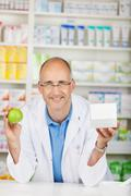 pharmacist with apple and box - stock photo