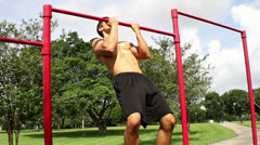 Handsome athletic guy pulls on the bar. Pull ups Stock Footage