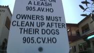 Stock Video Footage of Dog Clean up Dispenser and City Ordinance Signs