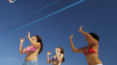 College Friends Laughing Enjoying Beach Volleyball - stock footage