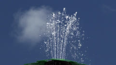 Water fountain against a blue sky. Stock Footage