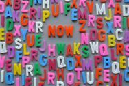 Stock Photo of colorful letter texture now word