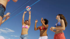 Multi Ethnic Teens Playing Beach Volleyball - stock footage