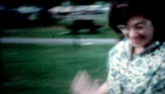 1960s Couple female chases male grass park summer day people lifestyle outdoors Stock Footage