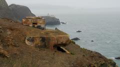 Historic bunker overlooking ocean Stock Footage