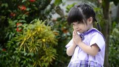 Cute asian baby girl in action salute with hand of thailand Stock Footage
