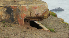 Close up on old bunker on overlook over ocean Stock Footage