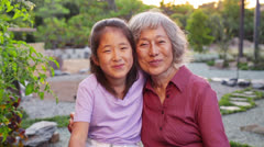 Asian Senior Woman Grandmother Hugs Grandchild Portrait Stock Footage