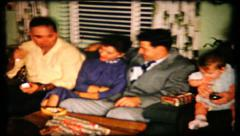 350 - family in living room on Christmas Eve - vintage film home movie Stock Footage